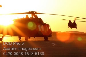Free Public Domain Picture: Setting Sun Casting Light on Military Helicopters Preparing For a Night Mission Photo