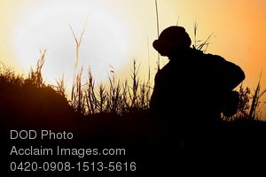 Free Public Domain Picture: Silhouette of a Marine, Walking In Tall Grass at Sunset, In Afghanistan Photo