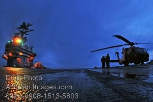 Free Public Domain Picture: Navy Personnel Preparing a Helicopter For Launch From the USS Abraham Lincoln Photo