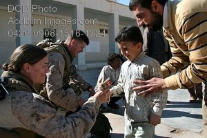 Free Public Domain Picture: American Soldiers Giving a Stuffed Animal To an Iraqi Child Photo
