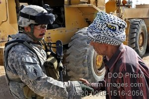 Free Public Domain Picture: Army Soldier Shaking Hands With an Iraqi Man