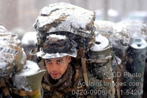 Free Public Domain Picture: Soldier, Carrying a Heavy Pack, Marching Through Snow Photo