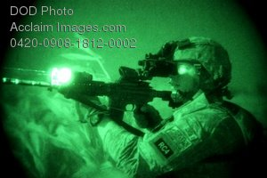 Free Public Domain Picture: Soldier, With a Raised Rifle, Seen Through a Night Vision Scope Photo