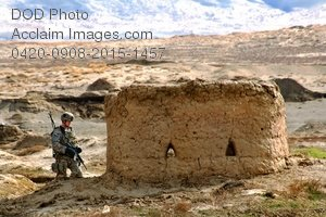 Free Public Domain Picture: U.S. Soldier Sitting Next To a Mud Hut In Afghanistan Photo