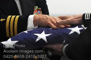 Free Public Domain Picture: Navy Commander Handing the American Flag To Another Navy Officer Photo