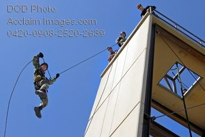 Free Public Domain Picture: Soldier Rappeling Down a Tower Photo