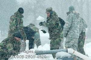 Free Public Domain Picture: Soldiers Putting Sandbags on a River Bank In the Snow Photo