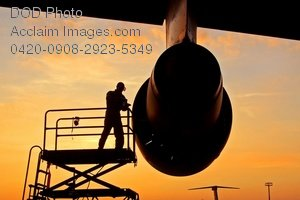 Free Public Domain Picture: Crew Member Checking the Engine of a C-5 Galaxy Aircraft Photo