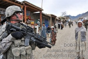 Free Public Domain Picture: Armed American Soldier Patrolling a Street In a War Zone Photo