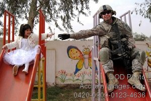 Free Public Domain Picture: American Soldier Playing With an Iraqi Girl
