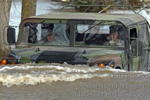Soldiers Driving a Humvee on a Flooded Road Photo