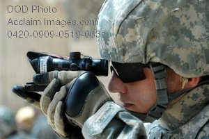 Free Public Domain Picture: American Soldier Looking Through an Optical Gunsight Stock Photo