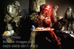 Picture of Soldiers Enjoying a Hot Meal - Free Photo