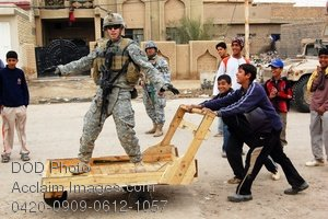 Free, Public Domain Picture of American Soldier Playing with Iraqi Children