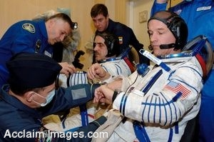 Clip Art Picture of Astronauts Preparing for a Mission