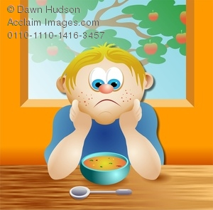 unhappy kid not wanting to eat his bowl of soup for lunch