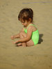 Girl Playing in Sand clipart
