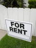 For Rent Sign in Front of a House or Apartment clipart
