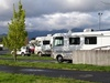 Recreational Vehicles Parked in a Parking Lot clipart
