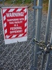 Warning Sign On a Chain Link Fence clipart