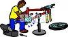 Man Fixing a Broken Bike clipart