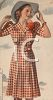 1940's Woman Modeling a Check-Patterned Dress clipart