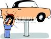 Mechanic Putting a New Tire on a Car clipart