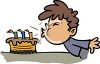 Child Blowing Out His Birthday Candles clipart