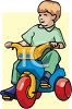 Little Boy Riding a Toy Trike clipart