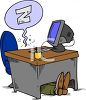 Cartoon of a Guy Sleeping Under His Desk clipart