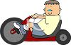 Boy Riding a Big Wheel Bike clipart