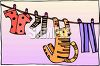 Cat Hanging From a Clothesline clipart