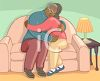 African American People Hugging on a Couch clipart
