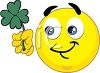 Smiley Holding a Four Leaf Clover clipart