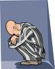 Depressed Man in Prison Wearing Striped Prison Pajamas clipart