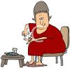 Diabetic Woman Testing Her Blood Sugar clipart