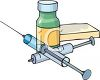 Hypodermic Syringes and a Bottle of Medication clipart
