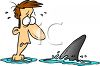 Cartoon of a Man Facing a Shark in the Ocean clipart