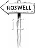 Wooden Sign Pointing the Way to Roswell clipart
