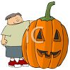 Cartoon of a Boy Standing by a Huge Jack O' Lantern clipart