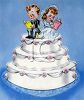 Old fashioned bride and groom on a wedding cake clipart