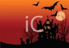 Haunted House and Graveyard at Sunset with Bats and Dead Trees clipart