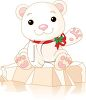 Baby Polar Bear Sitting on a Piece of Ice with a Holiday Bow Tied Around His Neck clipart