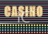 Lit Up Casino Sign with Colored Bulbs clipart