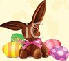 Cute Chocolate Easter Bunny Sitting with Easter Eggs clipart
