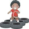 Little Black Boy Running the Tires in an Obstacle Course clipart