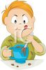 Cartoon of a Little Boy Stirring a Cup of Cocoa clipart