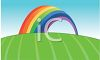 Rainbow Arching Over a Grassy Field clipart