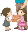 Little Girl Giving a Card to a Less Fortunate Girl clipart