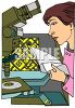 Woman at work in a laboratory in front of a microscope clipart